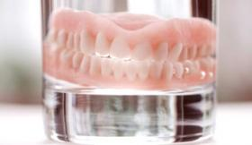 Dentures in glass